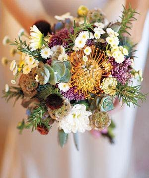 Sustainable bouquet out of succulents, dahlias, and rosemary.