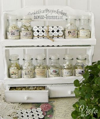 Vintage spice rack for craft storage.