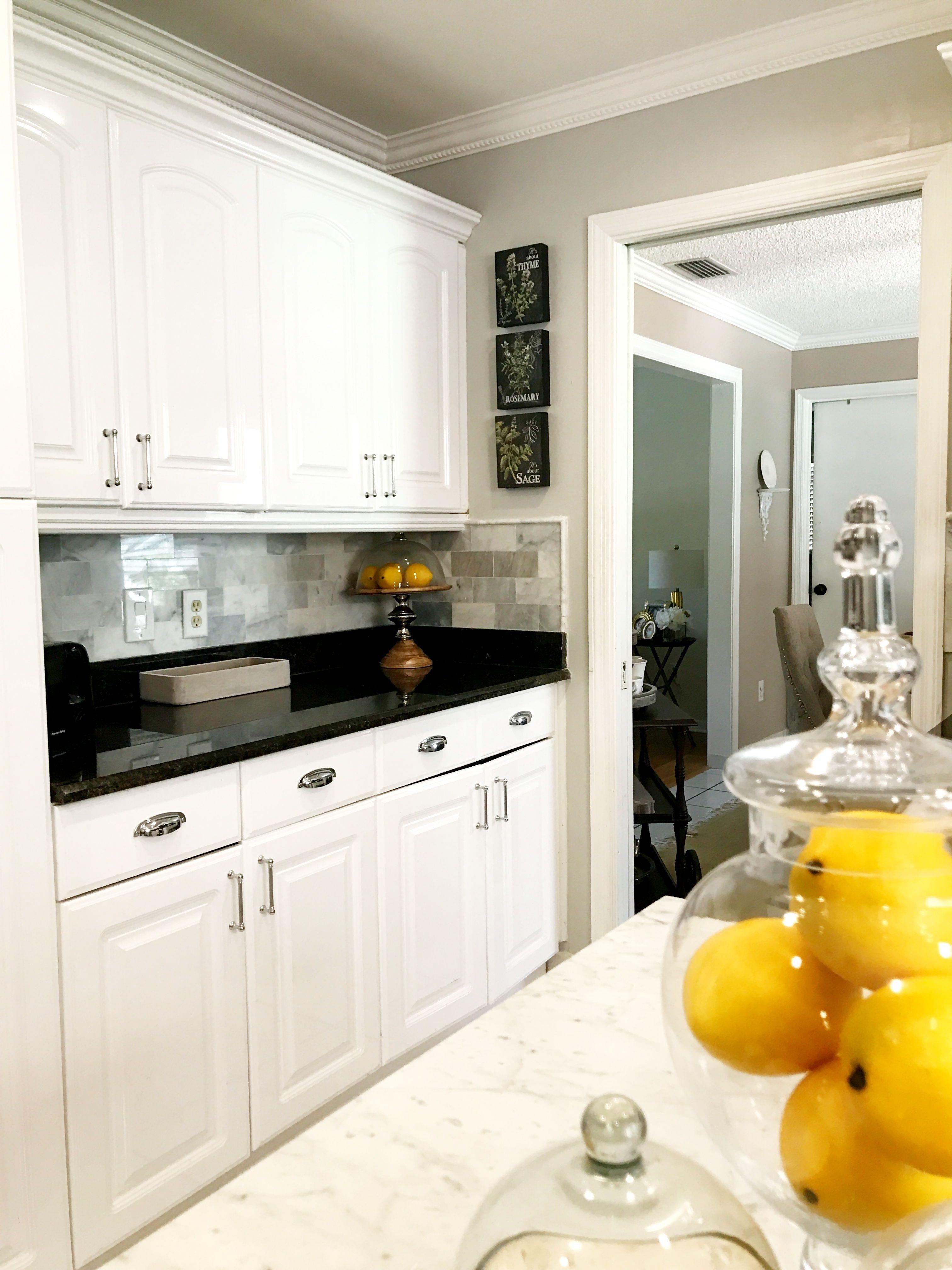 70s home makeover Carrera marble backsplash Repose gray wall paint
