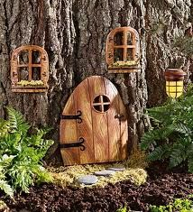Fairy tree house.... When we move, Carrie and I are doing this!!