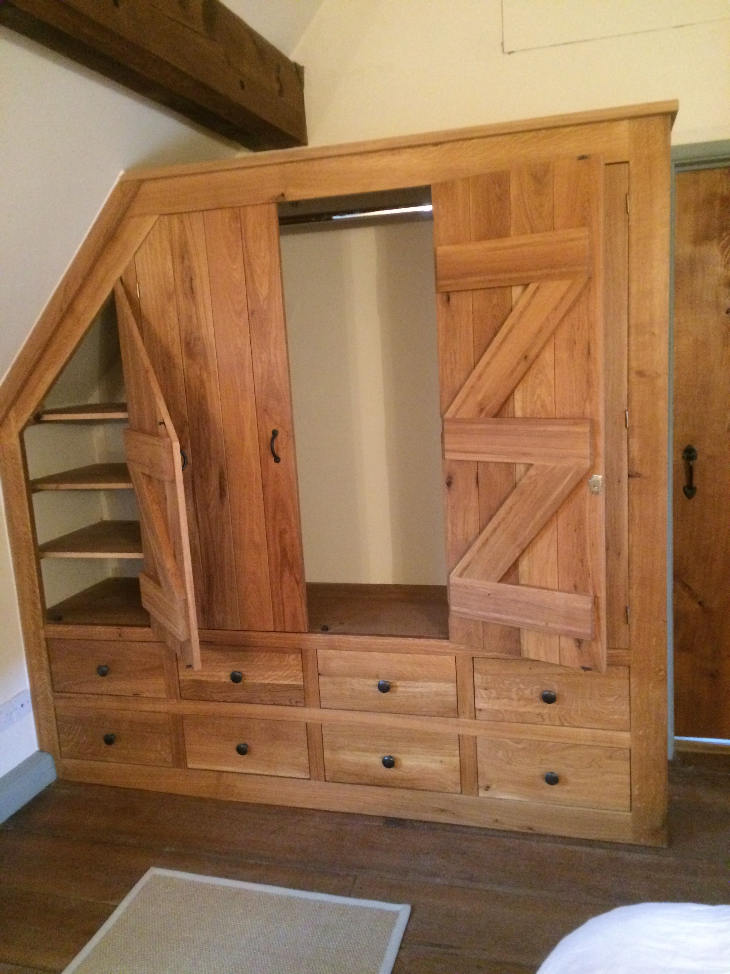 Ledge And Brace Doors Create A Traditional Feel To This Solid Oak Bespoke Fitted Wardrobe In Our Customer S Count Attic Flooring Attic Remodel Attic Renovation