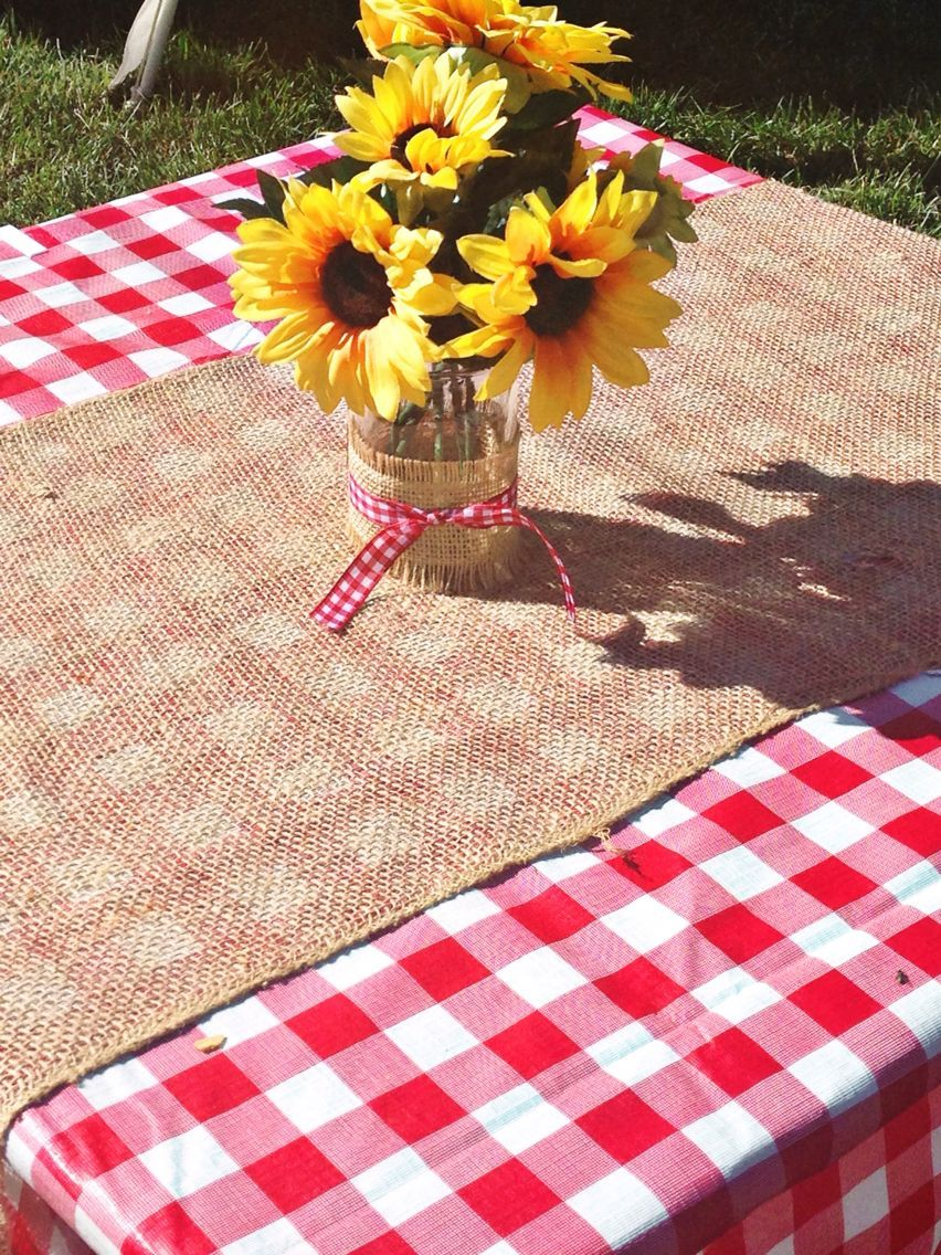 Babyq red gingham tablecloth with burlap runner and sunflower mason