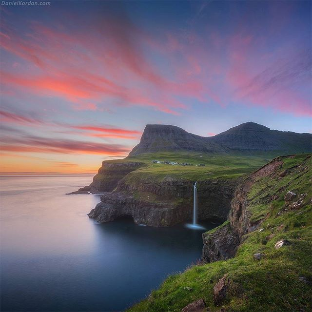 Daniel Kordan.Gasadalur should be the most iconic spot of Faroe islands. And I'm not surprised why: waterfall crashes into the sea with beautiful mountains around... You can see a small village #gasadalur right above the waterfall. Danielkordan.com D810 +14-24 + lucroit gnd filter soft #Faroeislands #faroe #visitfaroeislands