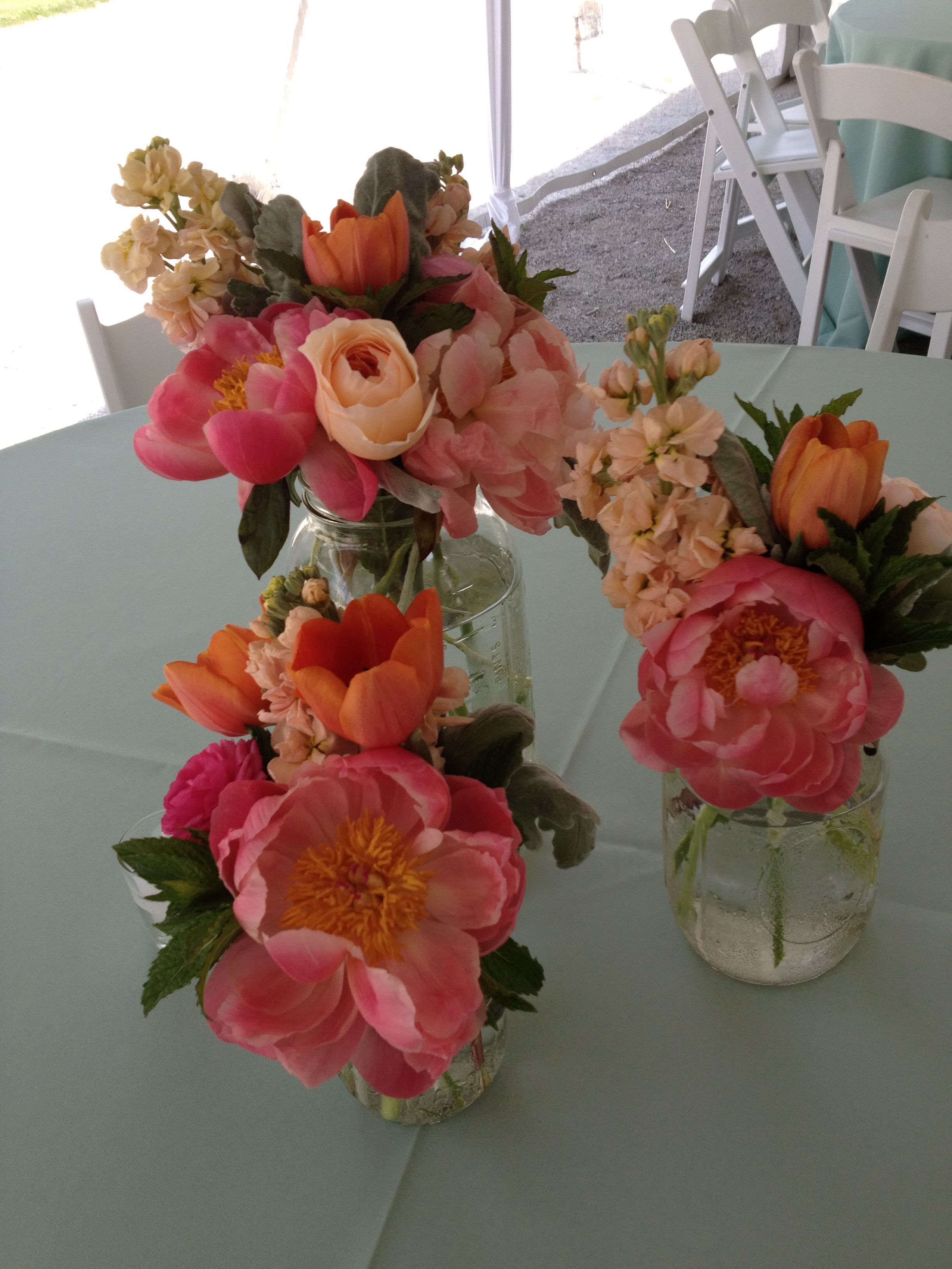 Centerpiece Scheme For Long Rectangular Tables. Multiple Small Floral  Arrangements In Mismatched Glass With Candles