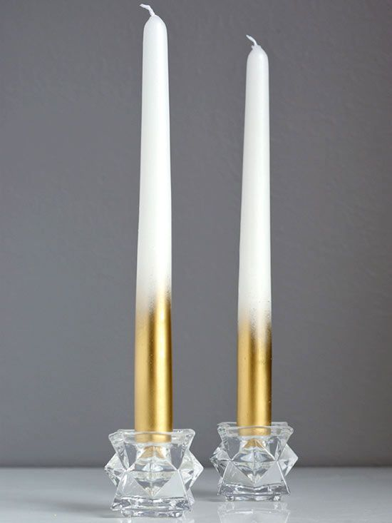 White tapers dazzle from top to bottom when enhanced with metallic paint. We think it's brilliant how Jeran of Oleander and Palm used gold spray paint to up the glam factor of everyday candles. Get all the details at Oleander and Palm.