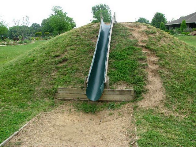 The Learning Landscape Playground Hills And Embankment Slides Backyard Slide Backyard Playground Playground Slide