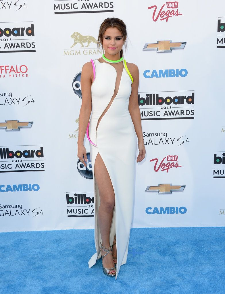 Billboard Awards 2013 - Selena Gomez chose a neon-infused Atelier Versace Spring '13 gown, complete with a sexy thigh-high slit. To finish, she wore silver metallic sandals and a high ponytail
