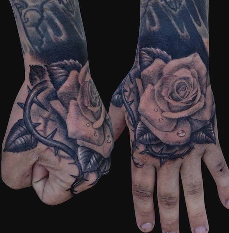 hand tattoos hand rose tattoo design of tattoosdesign. Black Bedroom Furniture Sets. Home Design Ideas