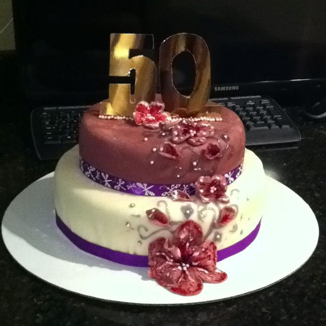 50th Birthday Cake for Mom Baked by my sister decorated by both