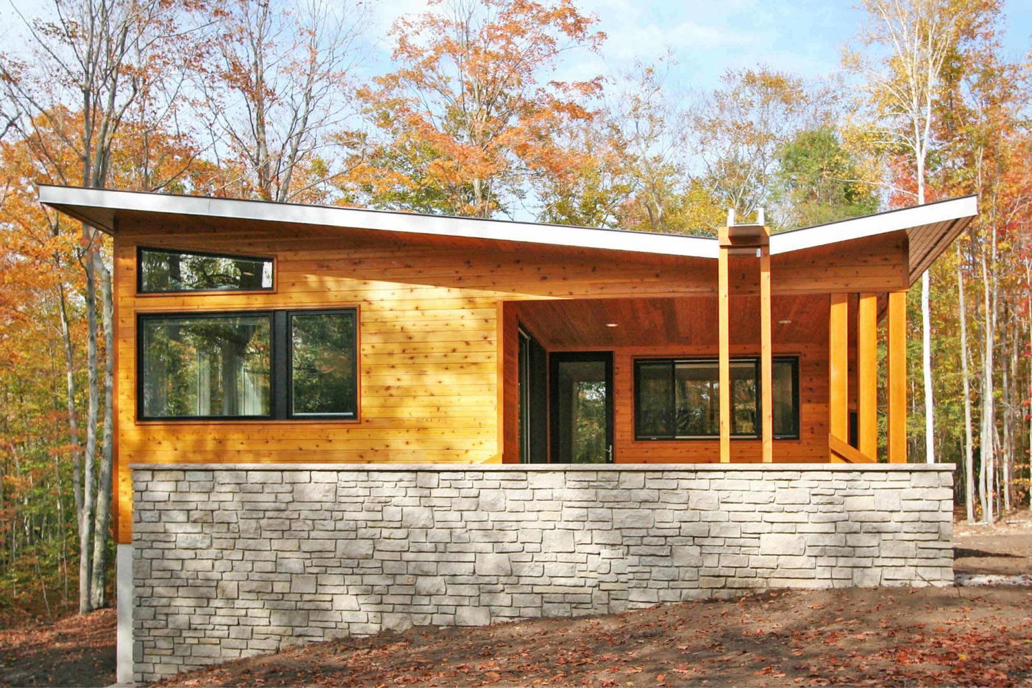 Modern prefab cabin house wisconsin butterfly roof for Prefab roof