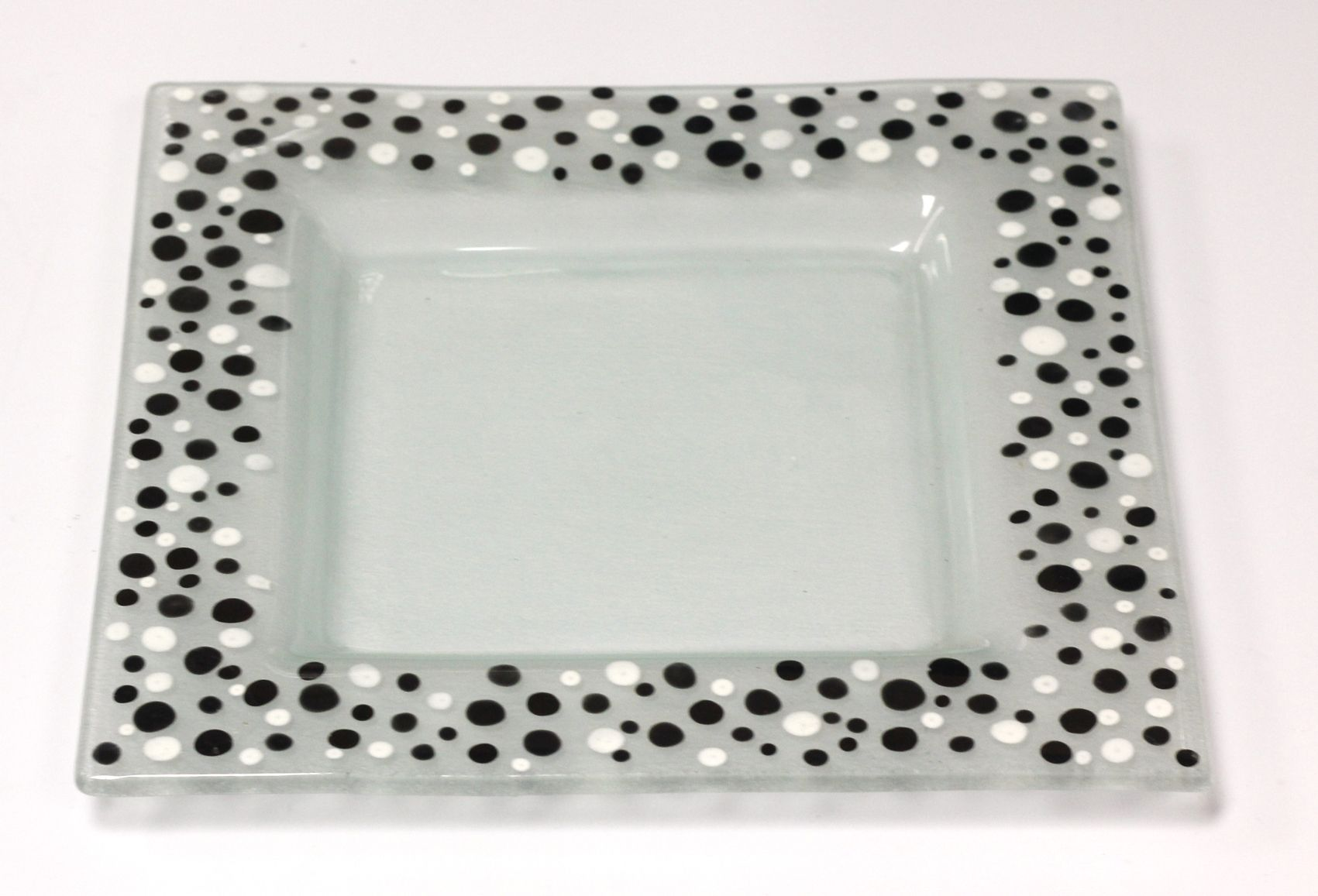 Square side plate with hand painted white & black dots on ...