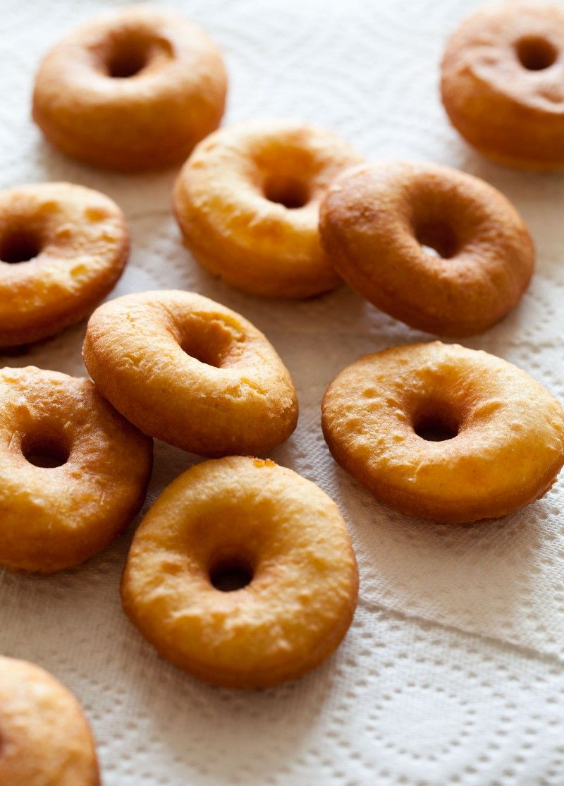 No Yeast Cake Doughnuts Makes 24  Ingredients: 1 quart peanut oil (or a 50/50 peanut and vegetable oil blend) doughnuts: 1 tablespoon vegetable shortening ½ cup sugar 1 egg yolk 1¾ cup plus 2 tablespoons all purpose flour 1 tablespoon baking powder ½ teaspoon salt 1 teaspoon cinnamon ½ cup whole milk glaze: 1 cup powdered sugar, sifted 2 to 4 tablespoons heavy cream (depending on desired consistency) vanilla  toppings: 2/3 cup chopped peanuts 2/3 cup coconut 1 cup powdered sugar,