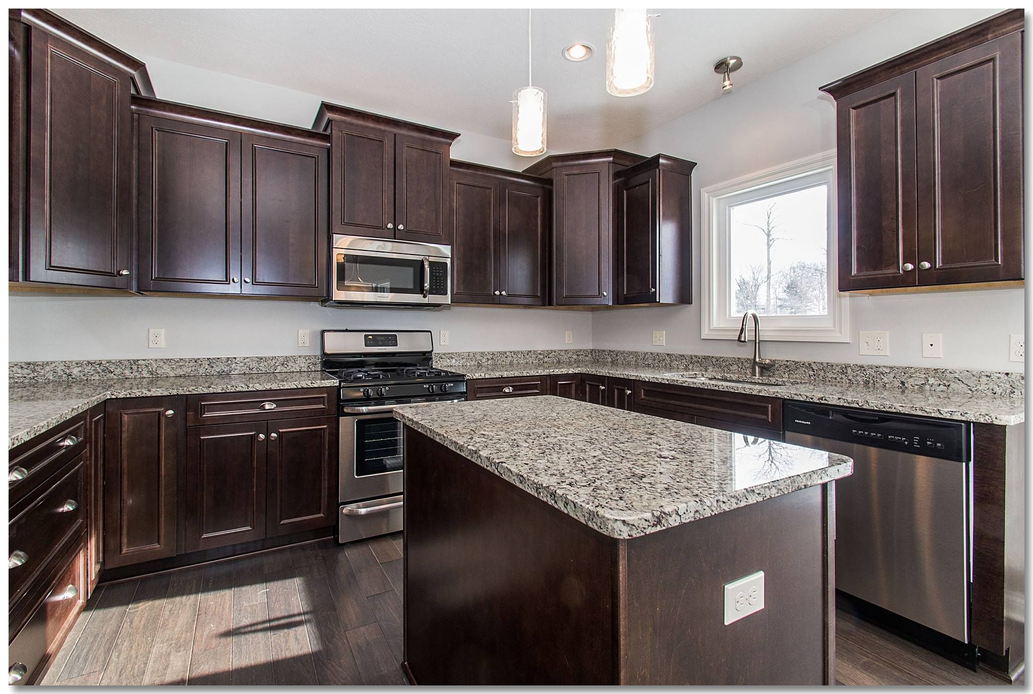 Traditional kitchen with espresso cabinets and granite ...