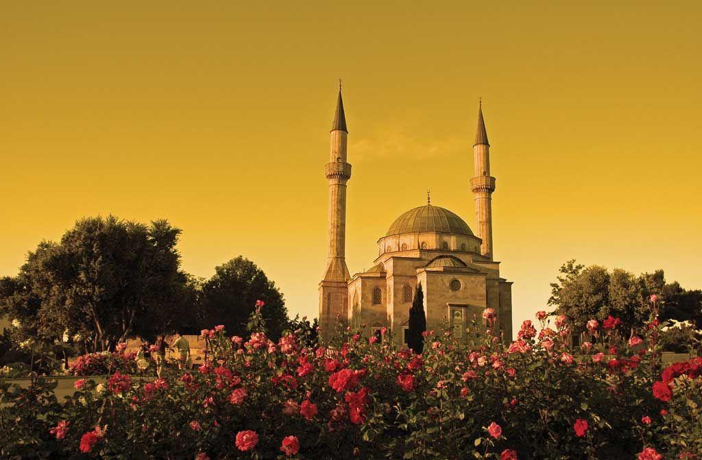 Mosque With Two Minarets In Baku Azerbaijan At Sunset Azerbaijan Travel Sacred Places Travel