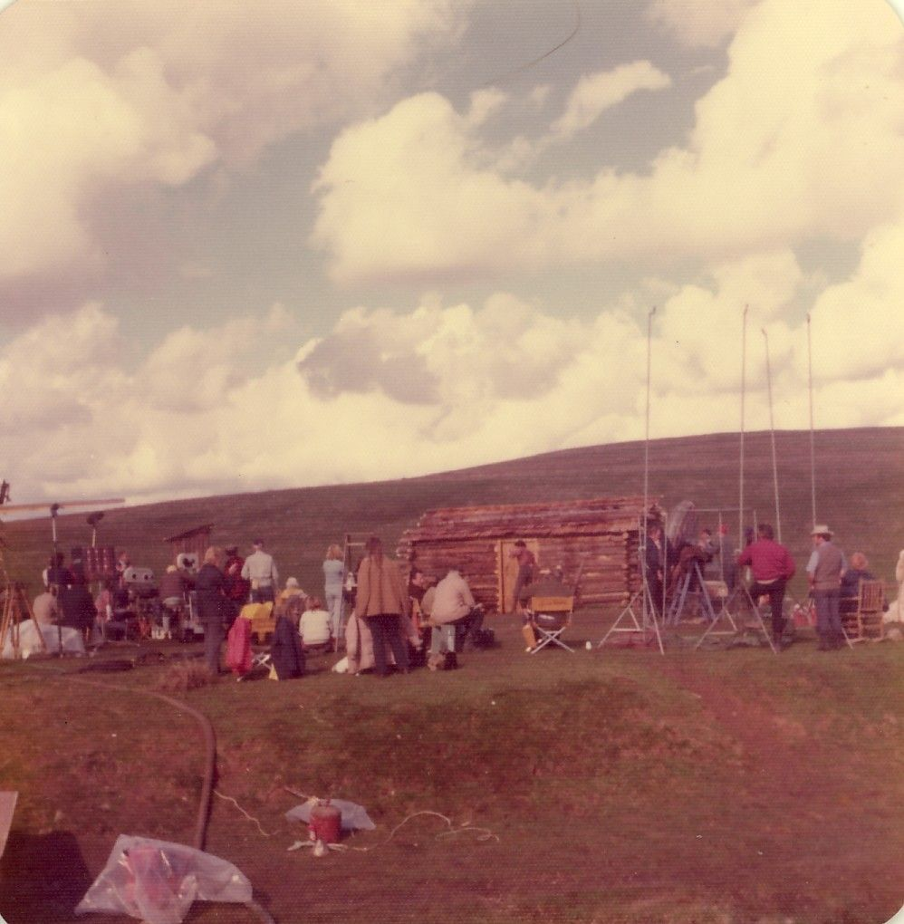 This photo was taken near Stockton, CA in the winter of 1974 during the shooting of the Little House on the Prairie pilot. You can see Michael Landon in the doorway, surrounded by camera, lights and crew.