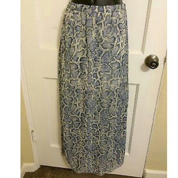 Slit maxi skirt Brand new  Has a slip, not see through socialite  Skirts Maxi