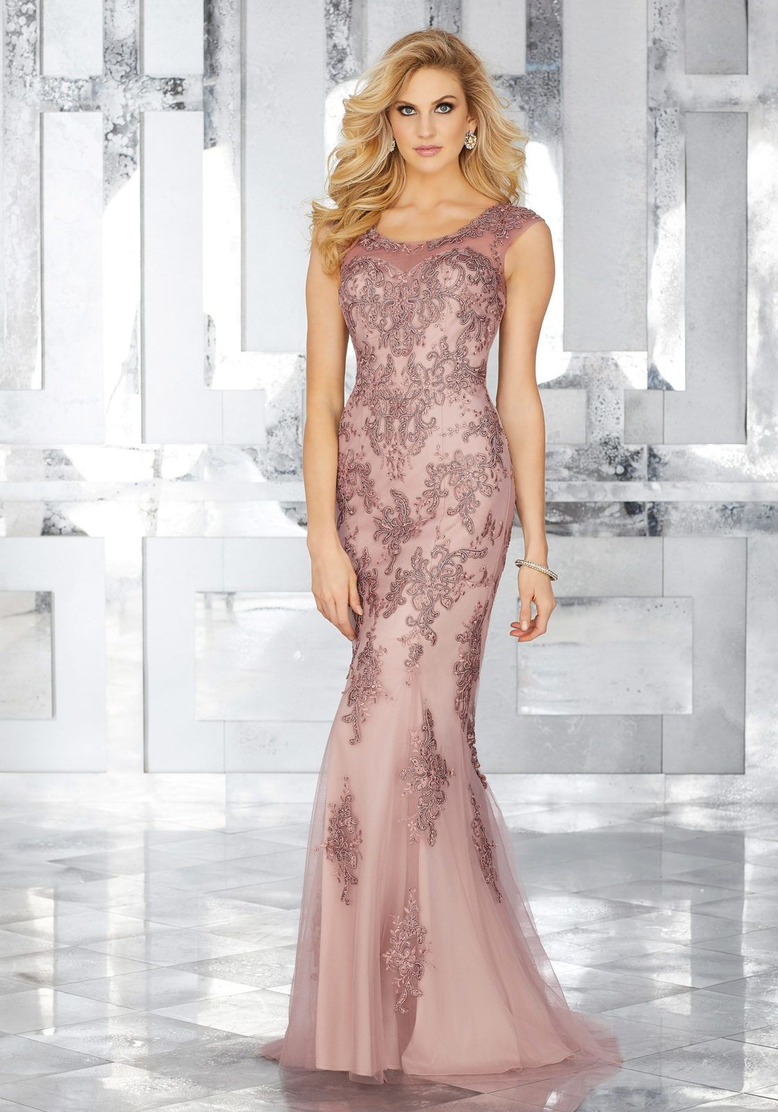 Form fitting special occasion gown featuring embroidered lace