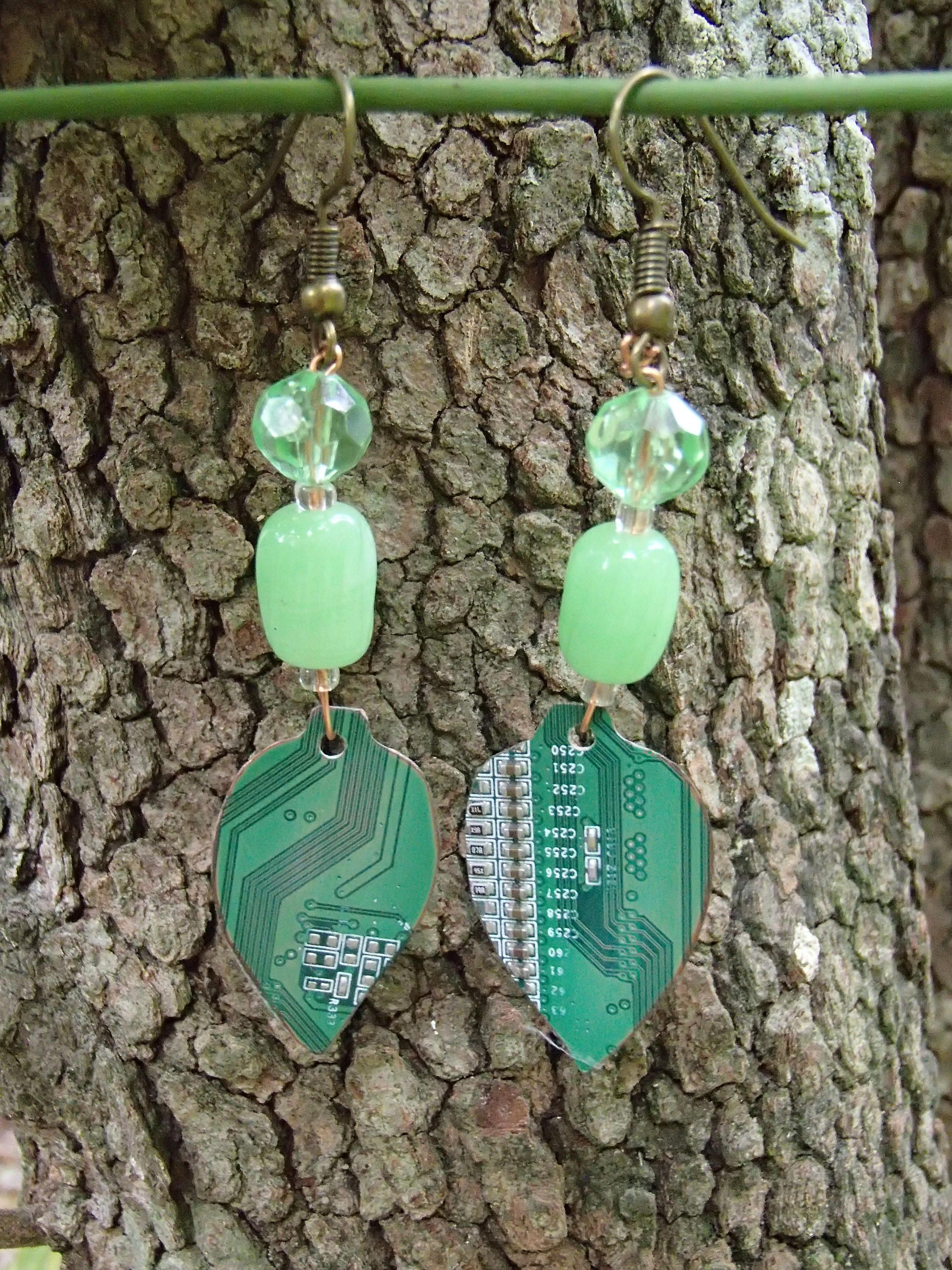 circuit board earrings shaped into leafs for organic look salvaged