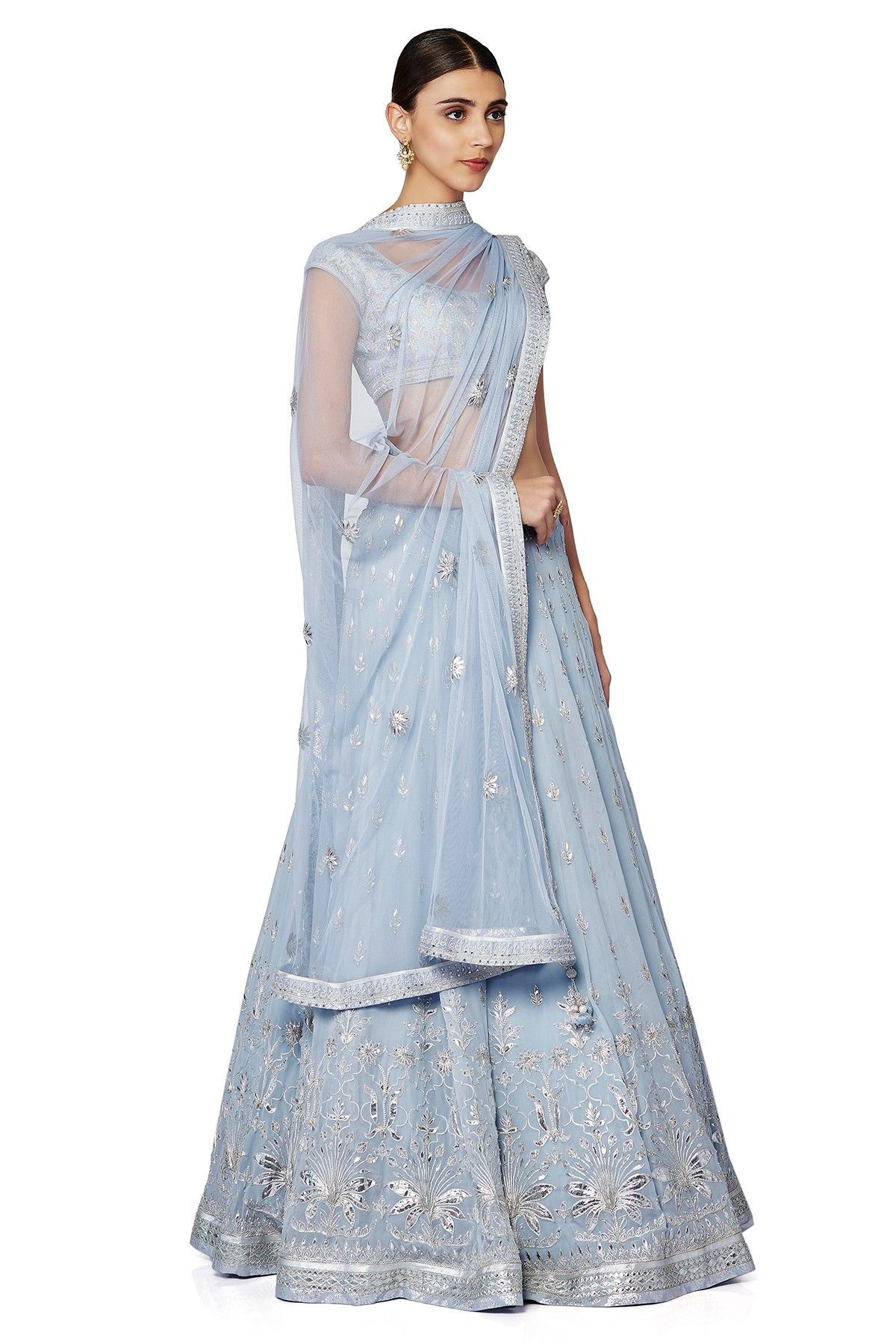 Artfully embellished with floral butti embroidery, this subtle ice ...