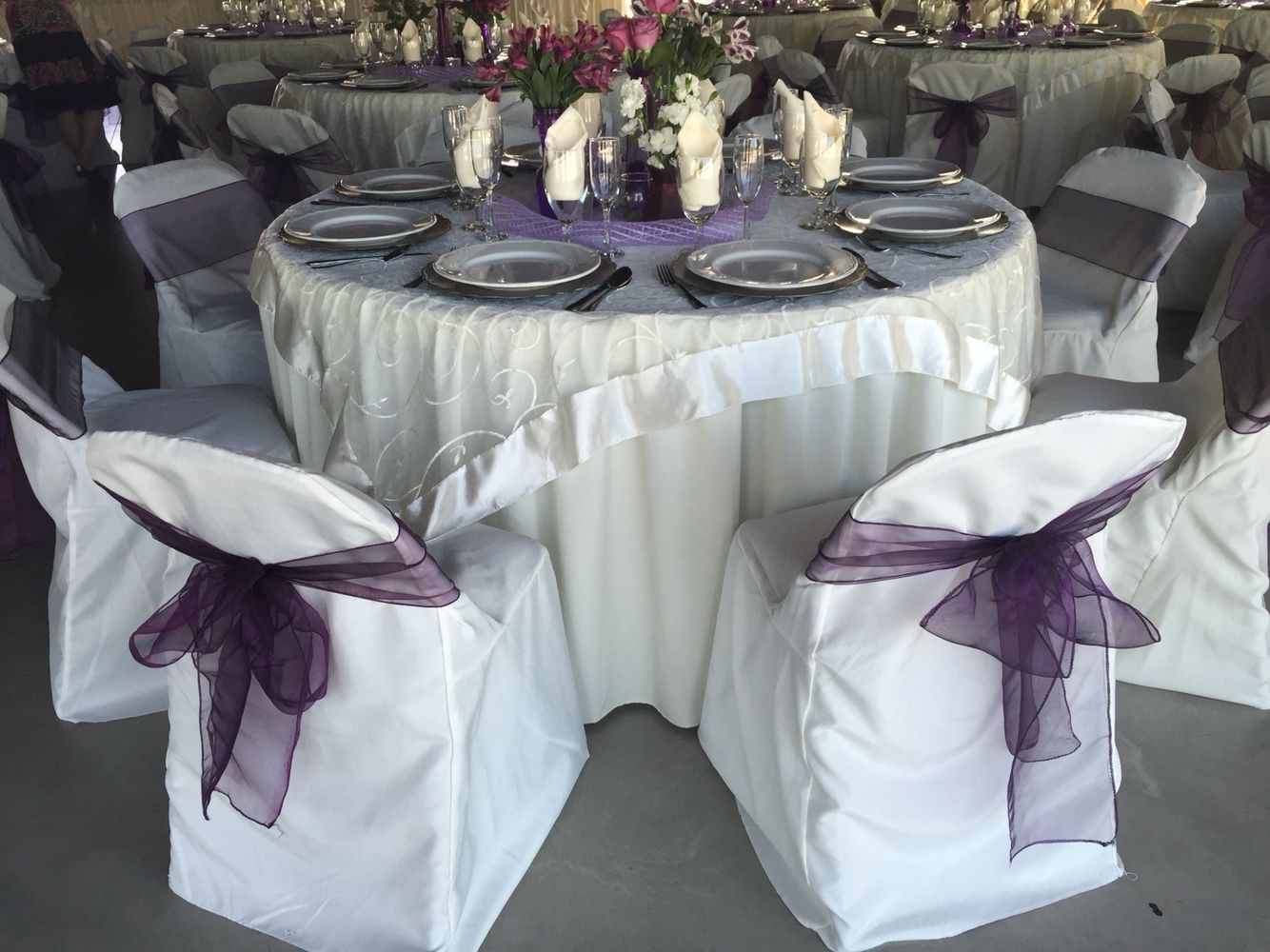 Ivory Table Cloth With Ivory Organza Overlay Accented With Plumb Chair Bows