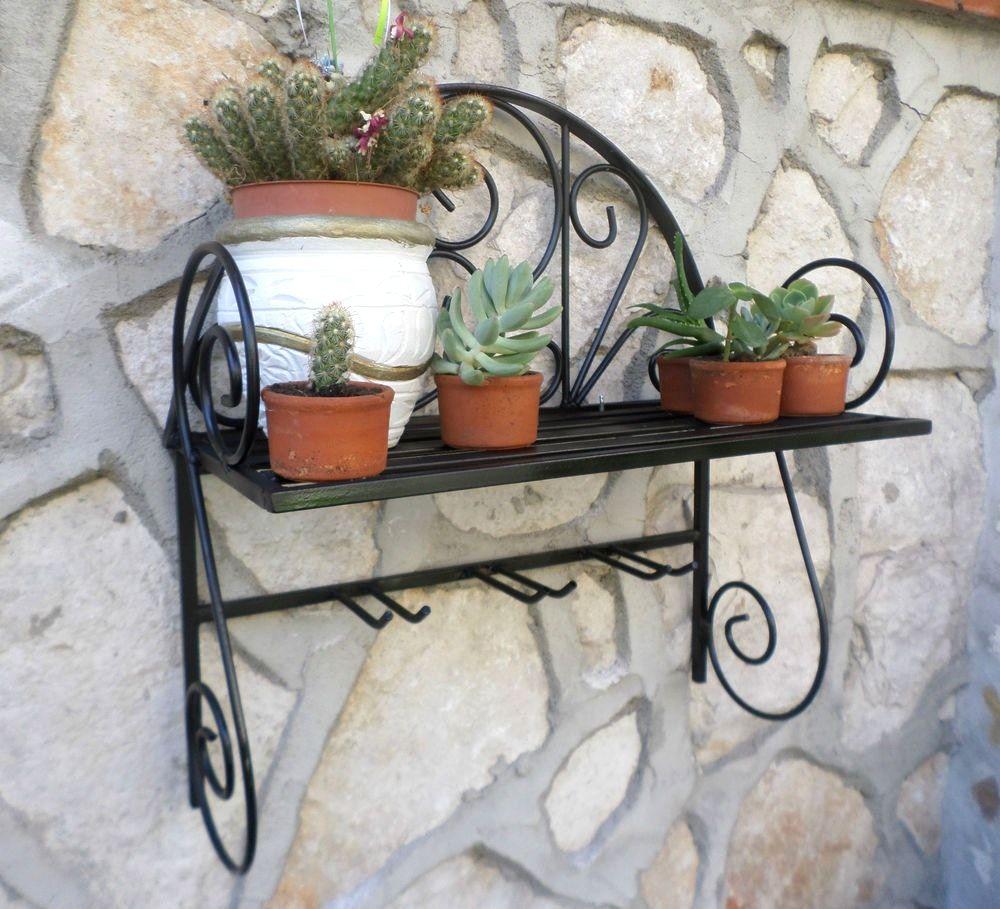 Idee decorative portavasi in ferro battuto da parete con - Porta vasi in ferro battuto ...