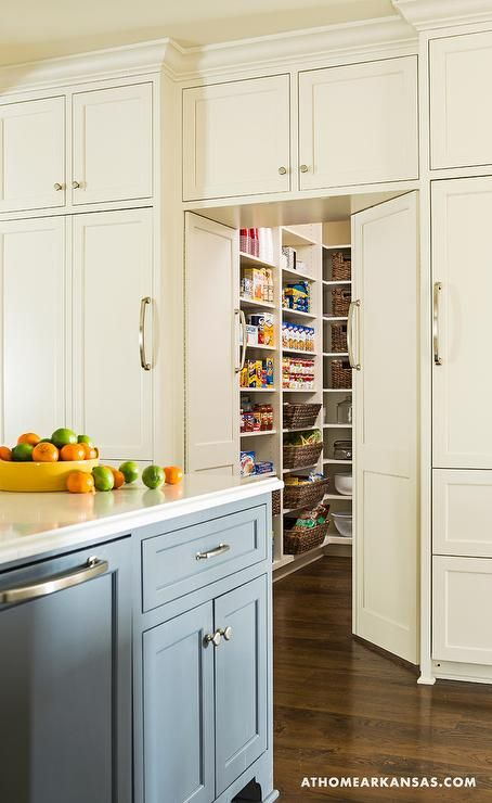 Fabulous Kitchen Features A Gray Blue Center Island Facing Ivory Bi Fold Doors Which Open To A
