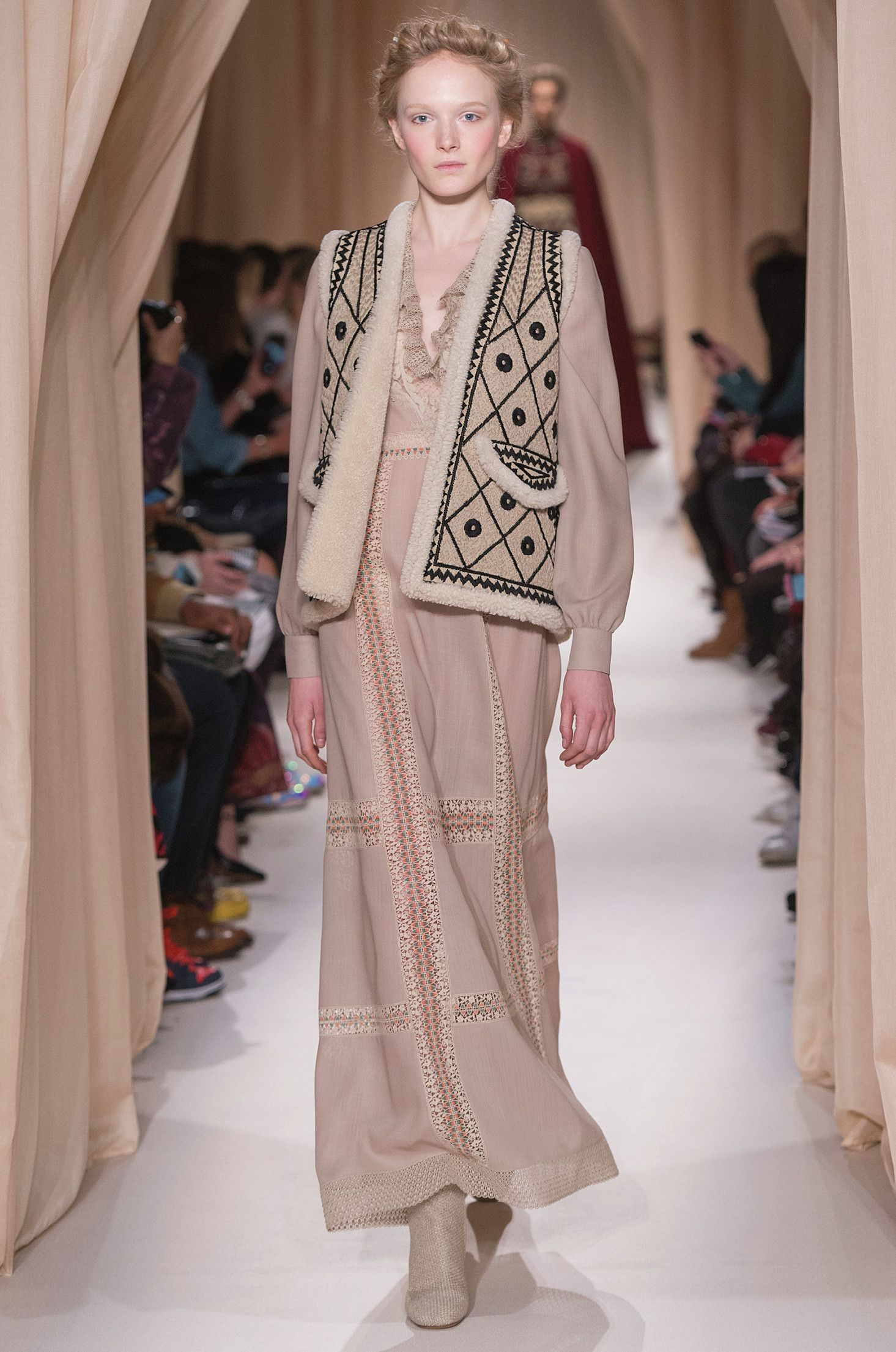 """""""La Cavalière"""", rope colored wool crêpe dress perforated in jasper colored guipure. Russian inspired gilet in sheepskin with embroideries of black threads and linen."""