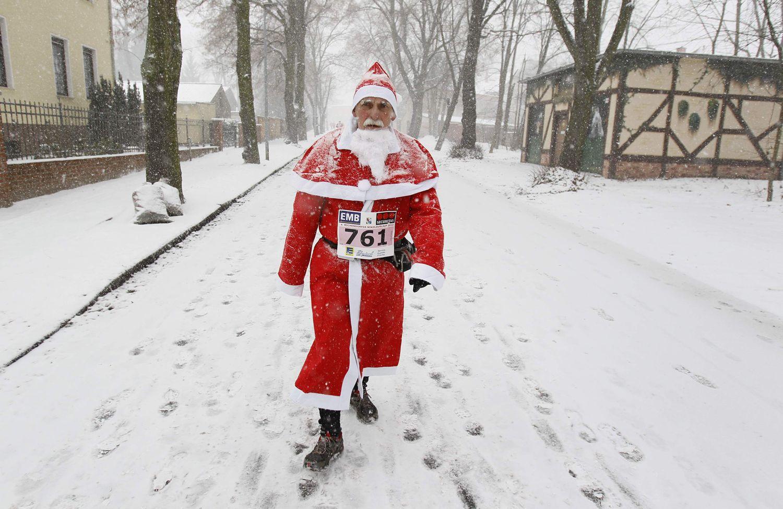Santa stampede! Germans run in red suits and beards
