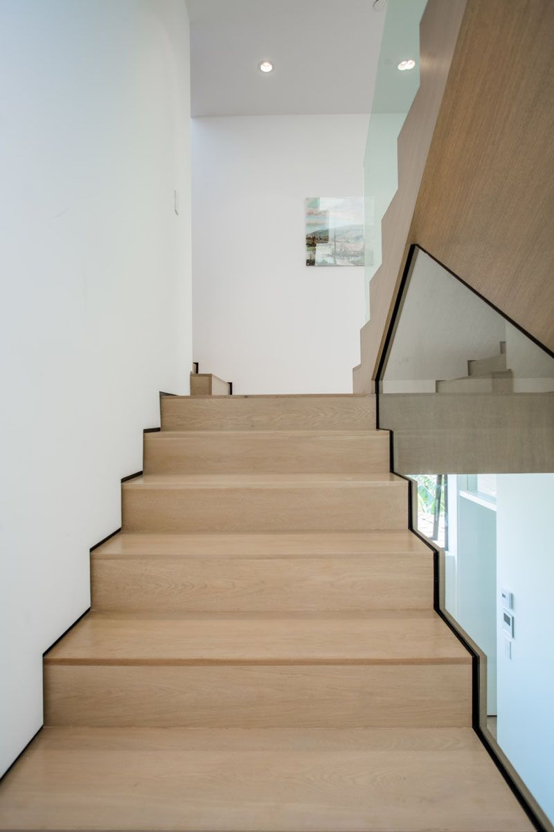 Lighting Basement Washroom Stairs: Light Wood Stairs Have Been Paired With White Walls And
