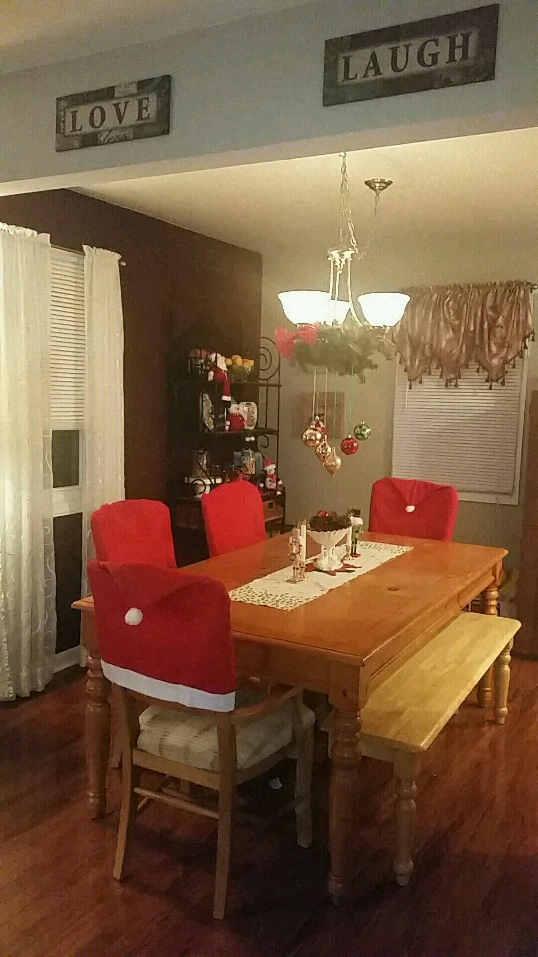 Mt dining room. Cover for chairs from dollar store Chair
