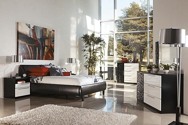 The Piroska Upholstered Bedroom Set From Ashley Furniture Home Afhs Two Toned High Gloss Black And White Finish Of
