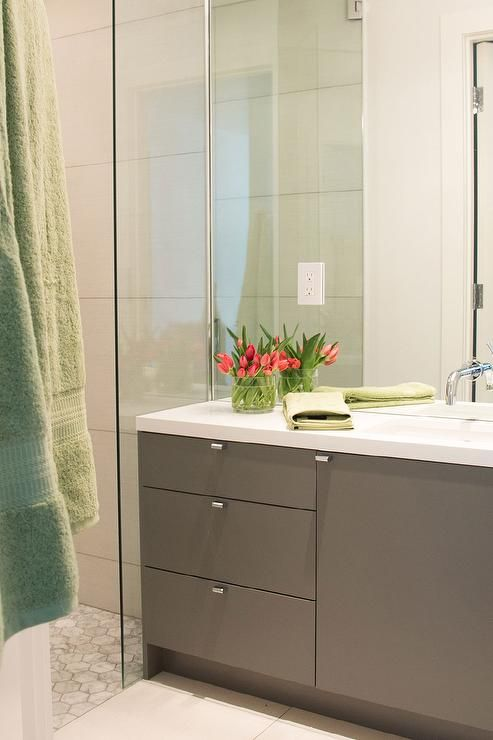 Contemporary Bathroom Features A Full Height Mirror Lined