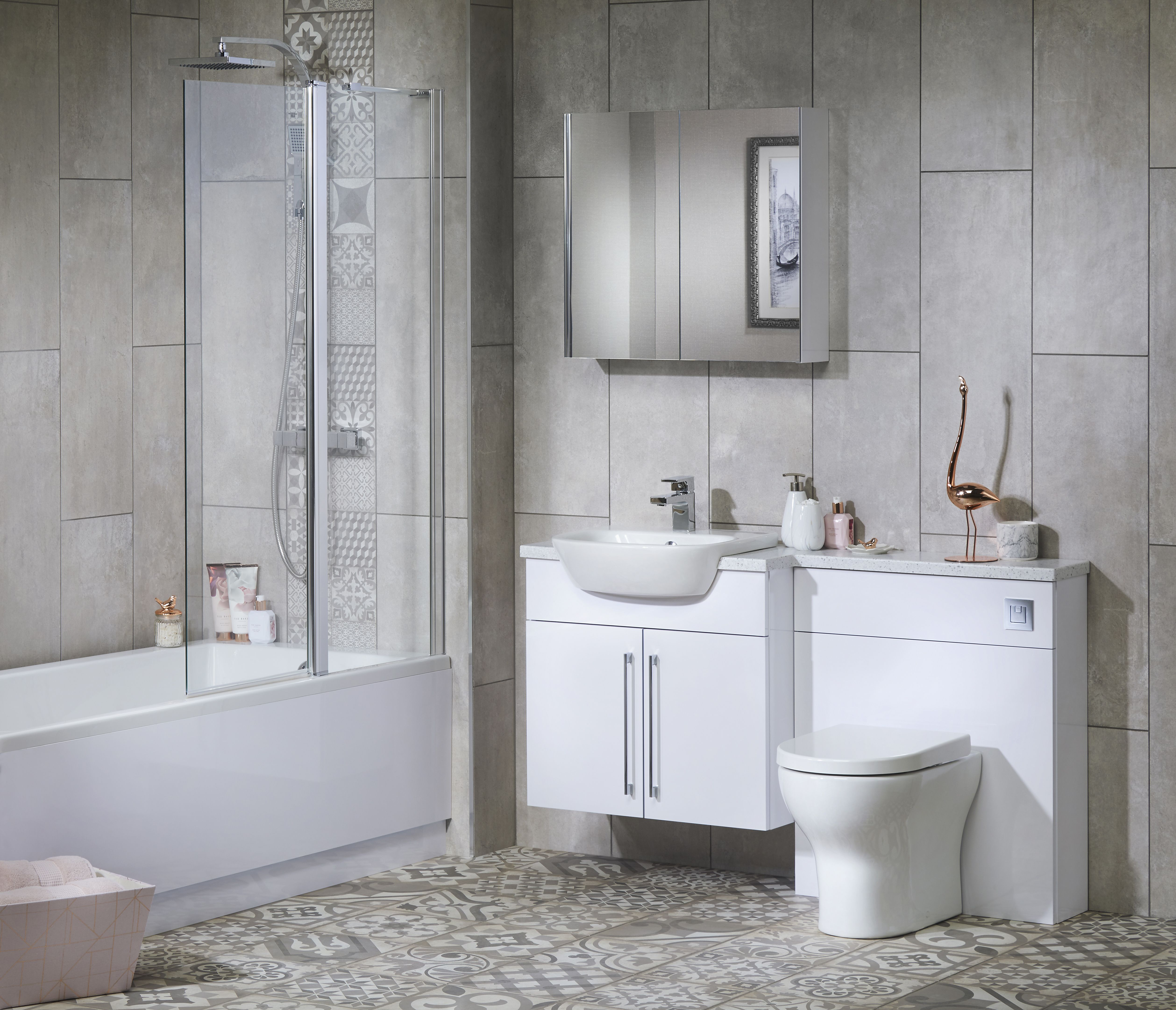 Make a compact bathroom feel more spacious by adding a mirror or