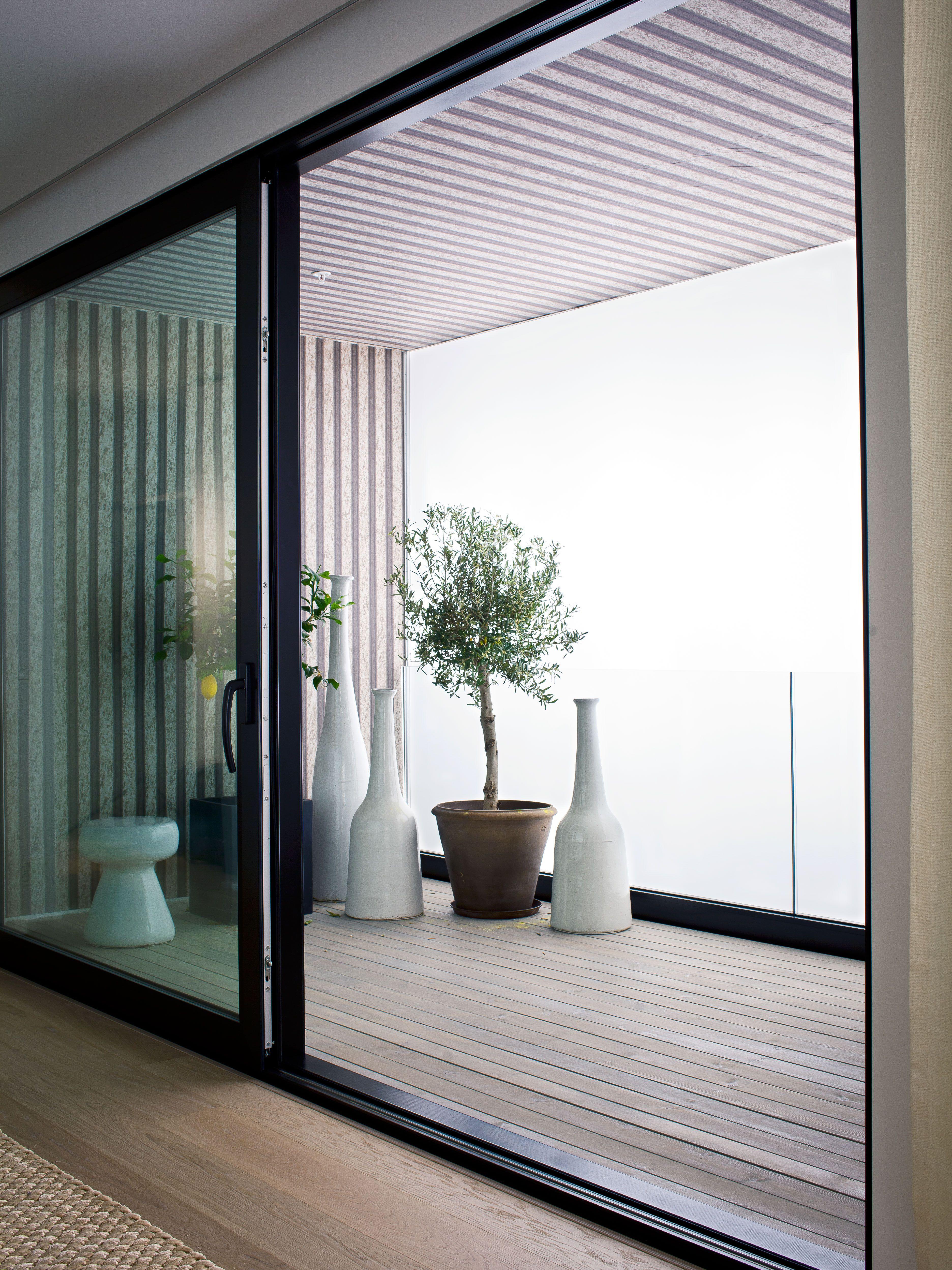 Oscar properties norra tornen balcony windows pots for Indoor balcony design