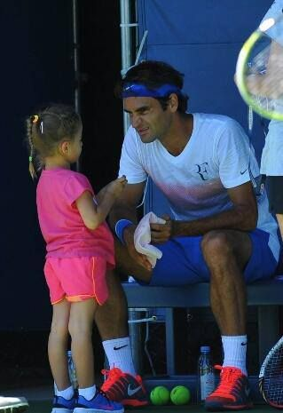 Hanging out with your kids ...giving his daughter attention, while at work!  Gotta love Federer! 24 August 2013 Federer Family