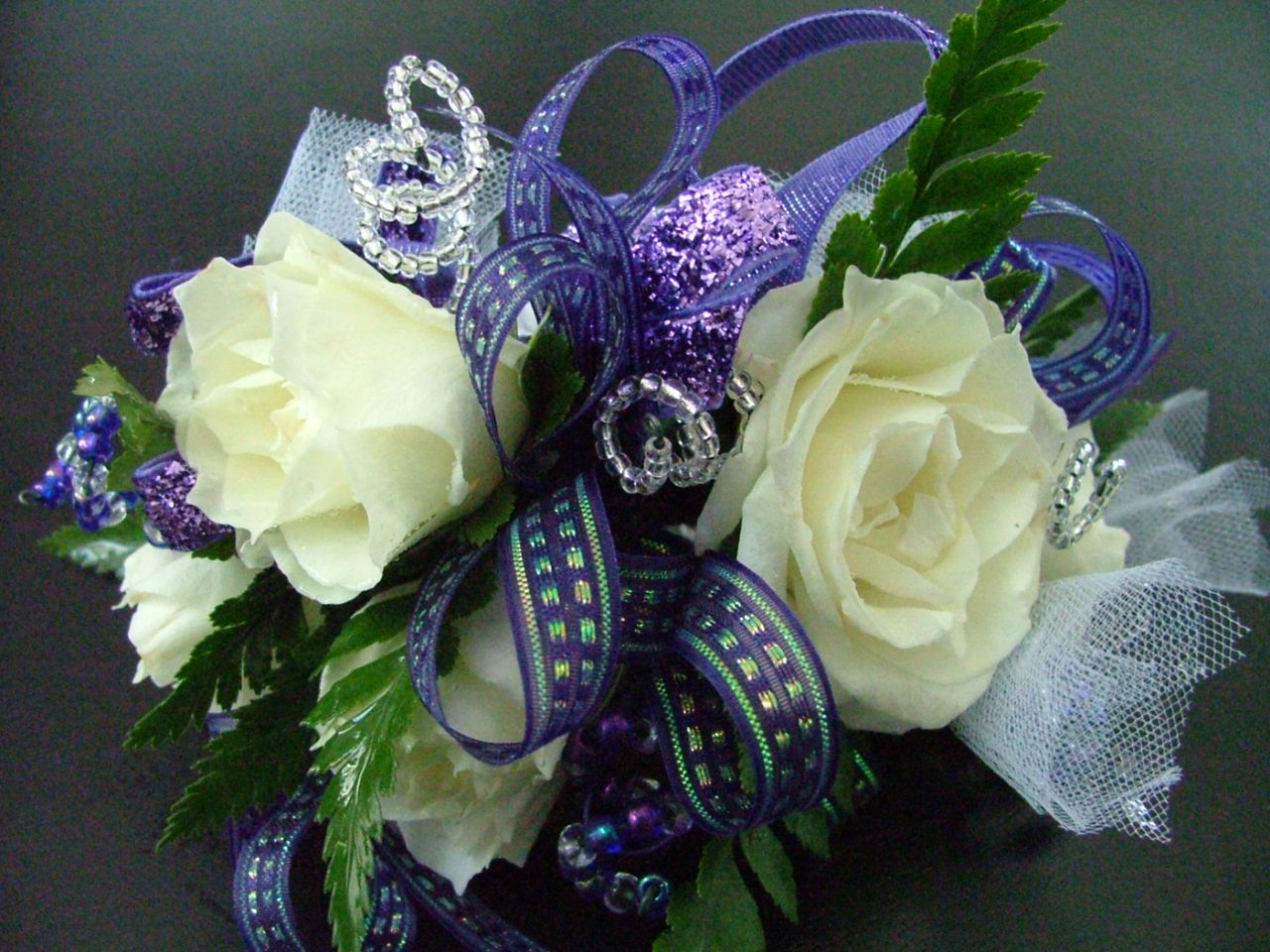Prom Corsage: White roses with royal purple accents and