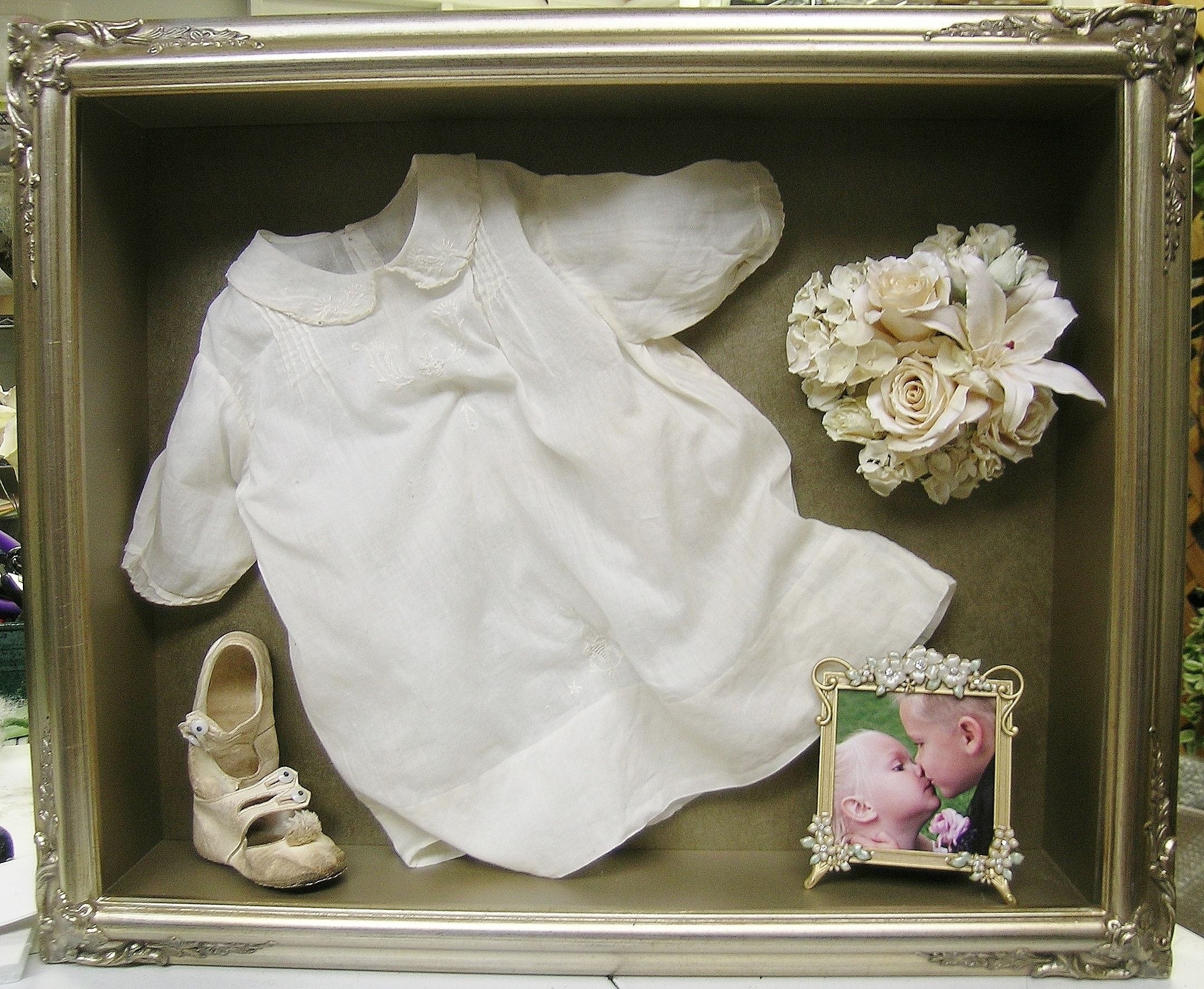 Christening gown with freezedried flowers framed by floral
