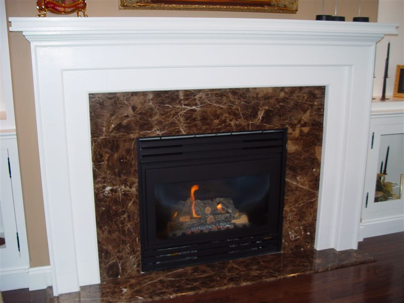Fireplace facing hearth in Emperador Brown marble Natural