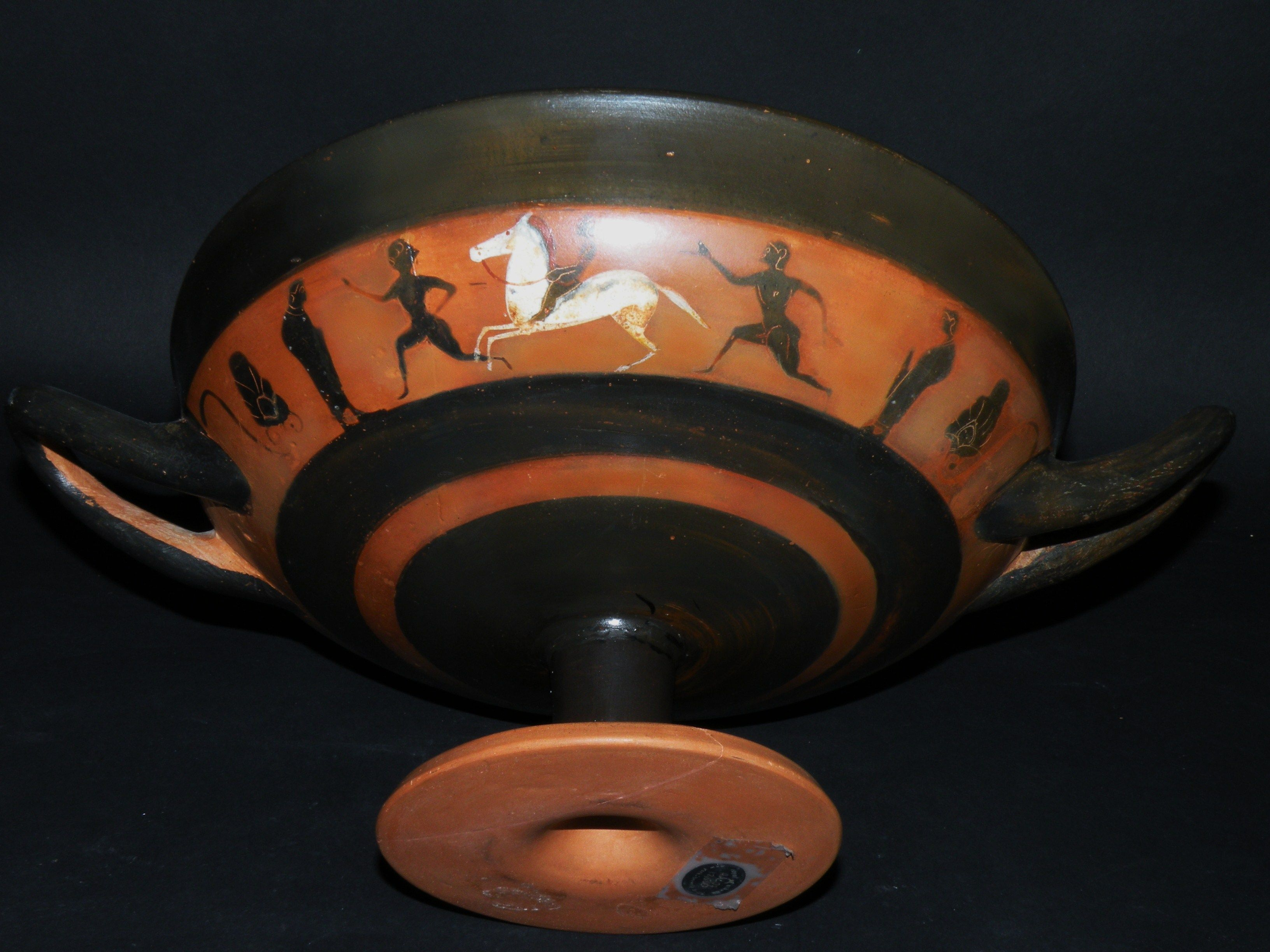 AN ATTIC BLACK-FIGURED KYLIX ATTRIBUTED TO THE LEAFLESS