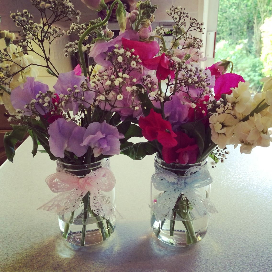 Flowers look so pretty in Jam Jars decorated with lace ribbon 🌷