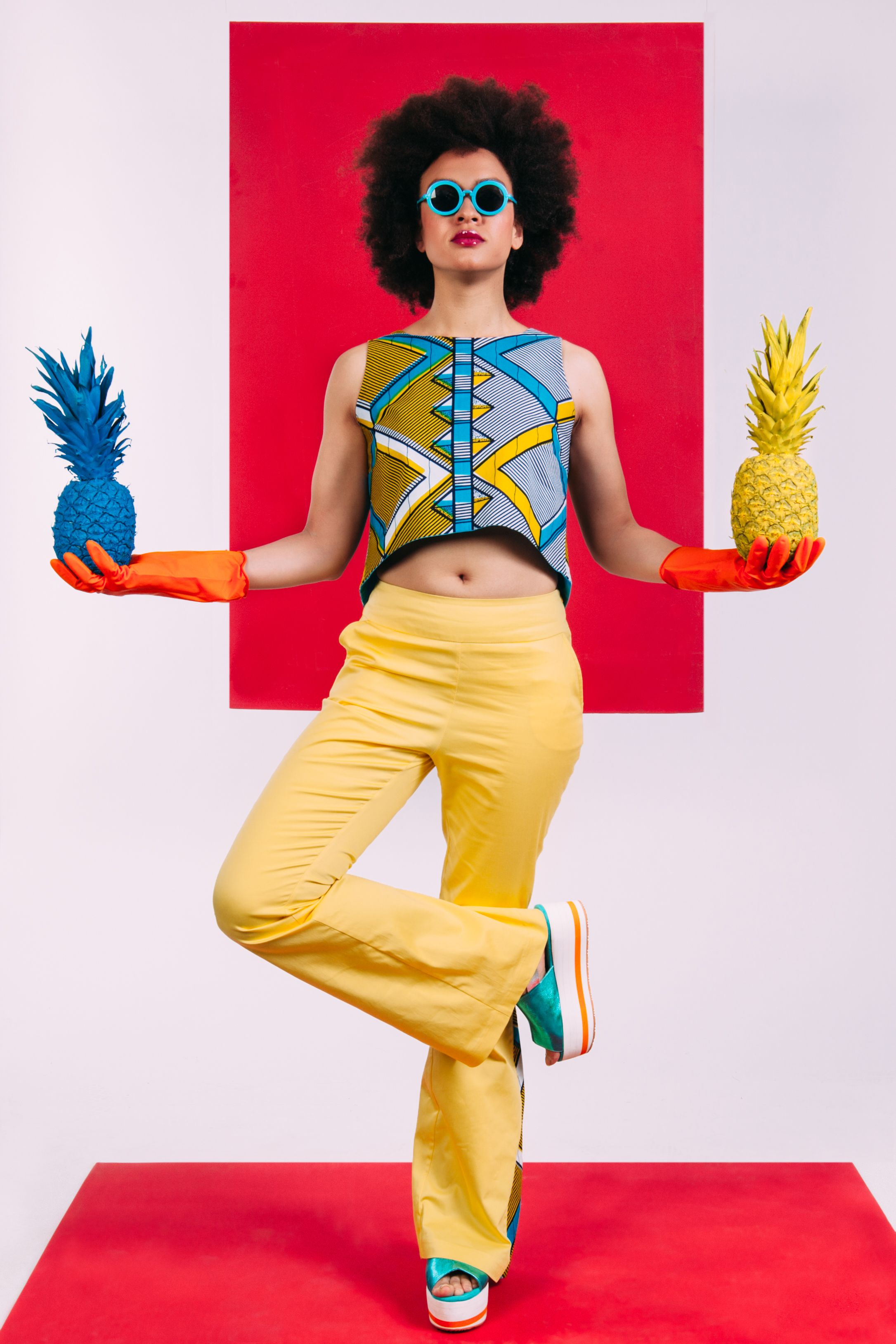Sista Yellow Bell-Bottom Pants, printed in colorfull design to break the uniformity. High fitted waist belt. Made of cotton with the elements of yellow rhombus African Wax Print, which is a good choice for any occasion during this warm summer. The pants match perfectly with with Sista yellow rhombus shirt, Sista blue shirt or Sista yellow rhombus mini shirt.