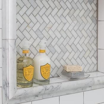 beautiful master bathroom boasts a walkin shower clad in white subway tiles accented with dark grout fitted with a arabescato carrera marble tiled shower