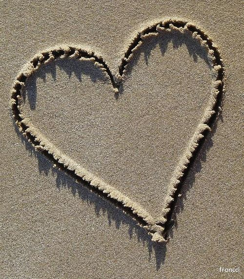 Sand...write names of engaged couple in the heart, take
