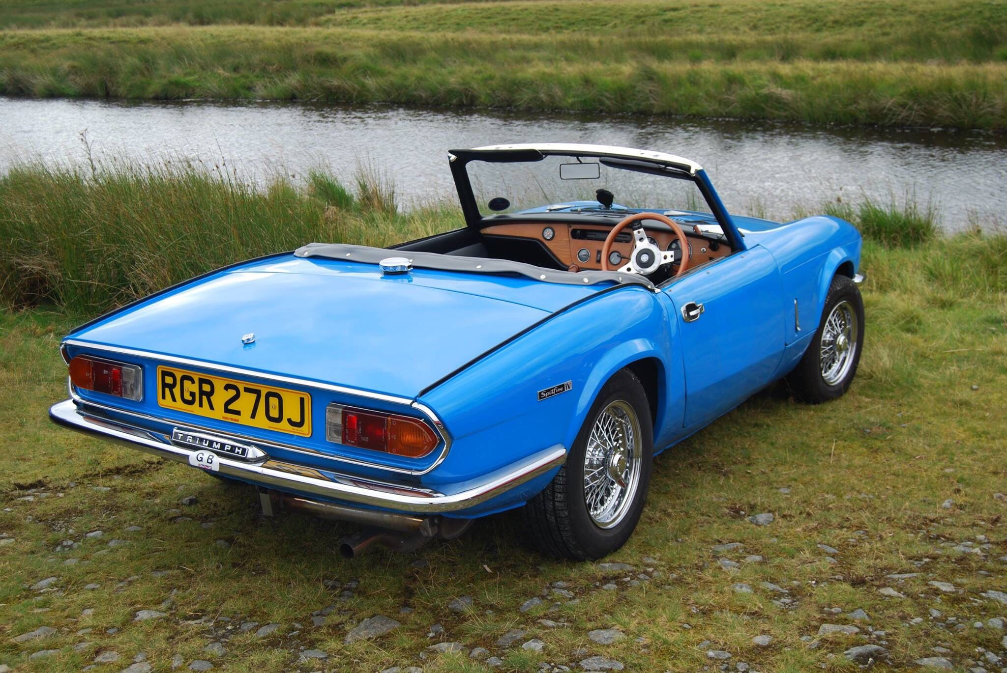 Triumph Spitfire Mk4 on wire wheels.