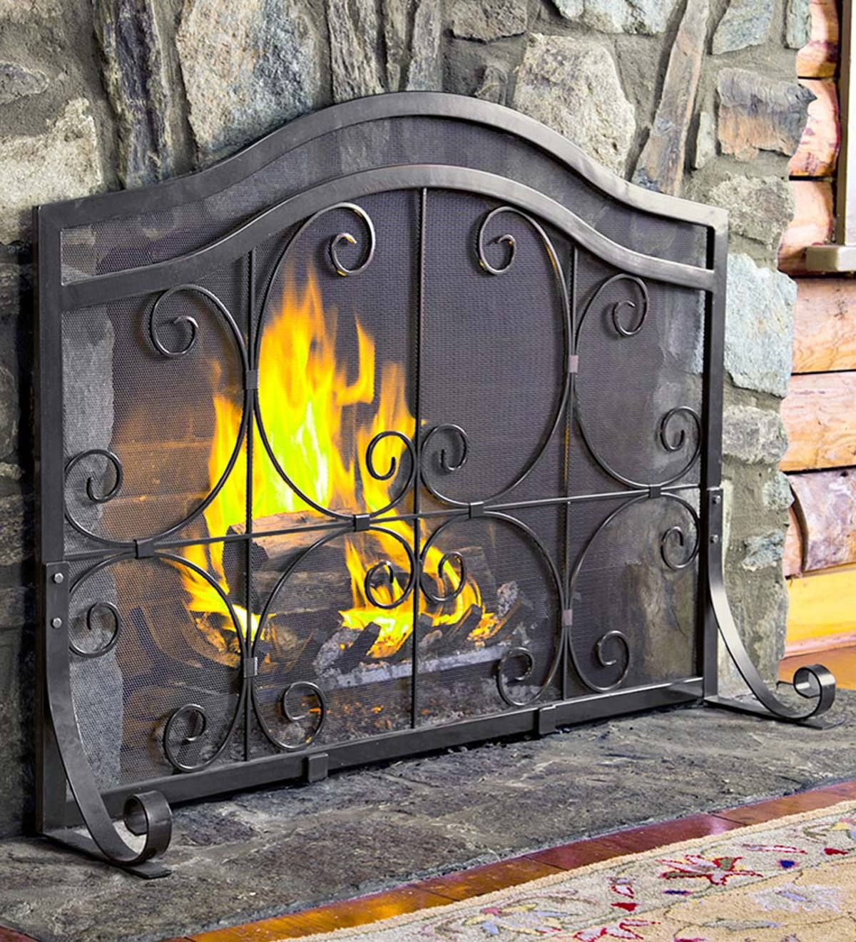 7715d07ca81 Ornamental scrollwork in solid wrought iron sets our exclusive Crest Fireplace  Screen with Doors apart. Each quality-crafted piece has a powder-coat base  in ...