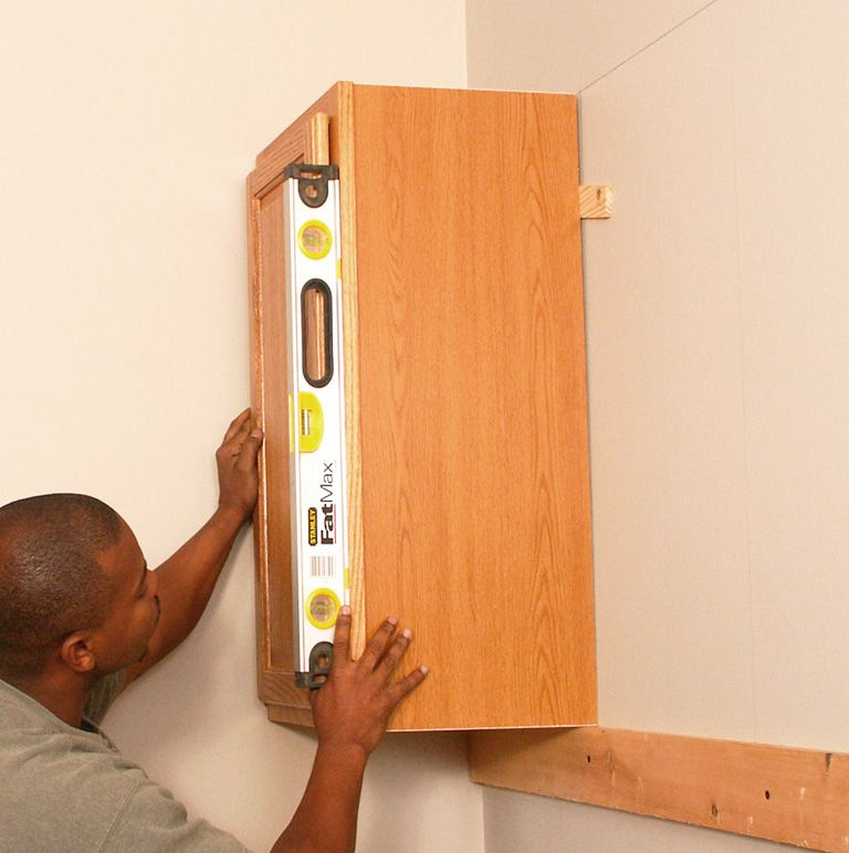 How To Install Kitchen Cabinets Hometips Installing Kitchen Cabinets Installing Cabinets Kitchen Wall Cabinets