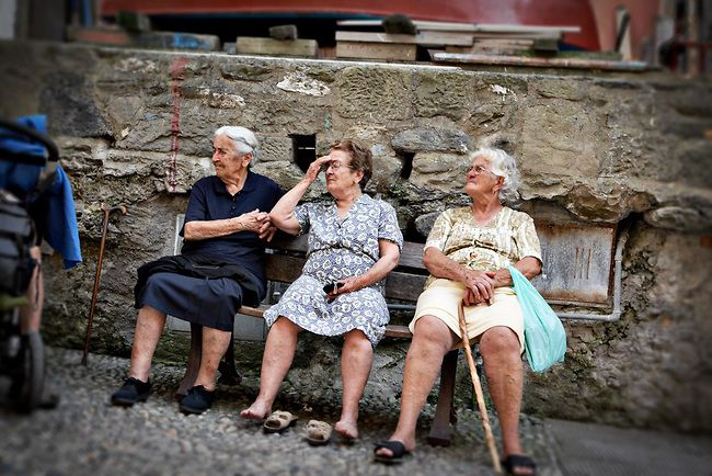 Portrait of three old women sitting on a bench in Vernazza, Italy © John Bragg Photography