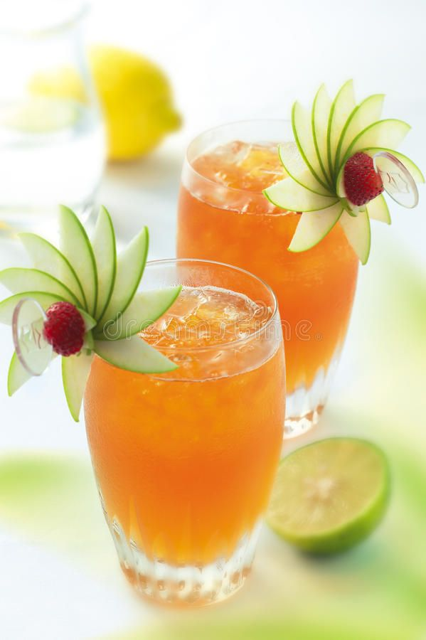 Photo about Two glasses of lemon lime cocktail. Image of ...