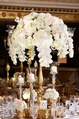 Orchid Hydrangea Ranunculus Wedding Flower Arrangement On Gold Stand Mercury Gl Candle Holders