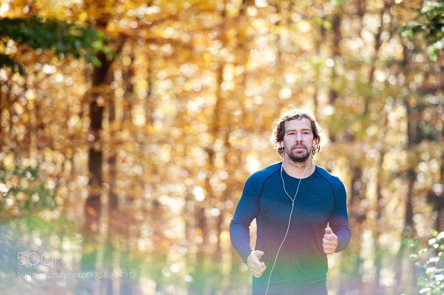 """Young handsome runner outside in sunny autumn nature"" by halfpoint via 500px.com Shop Fitness at FitnessCurious.com"